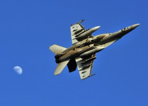 """An F/A-18F Super Hornet assigned to the """"Bounty Hunters"""" of Strike Fighter Squadron (VFA) 2 breaks to enter the landing pattern over the flight deck of Nimitz-class aircraft carrier USS Abraham Lincoln (CVN 72). U.S. Navy photo by MC2 James R. Evans"""