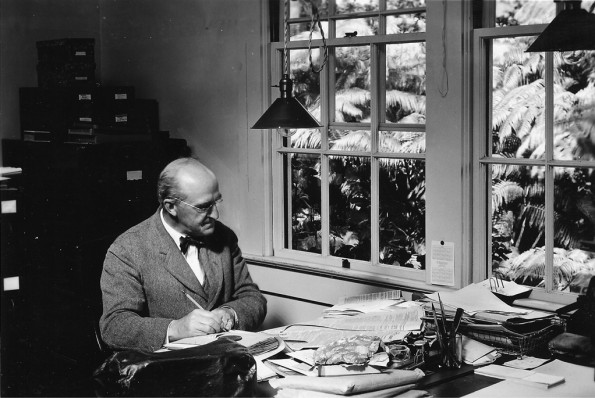 Thomas A. Jaggar founded the Hawaiian Volcano Observatory in 1912 and served as its Director until 1940. Shown here in 1925, Jaggar is at work in HVO'€™s first building, which, at the time, was located on the northeast rim of Kilauea Volcano'€™s summit caldera, near the present-day Volcano House hotel. Photo courtesy of USGS