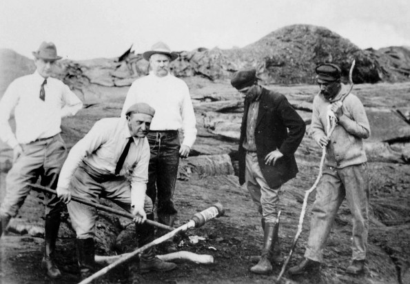 Thomas Jaggar (second from left) prepares to measure the temperature of the Halemaumau lava lake in 1917. Pictured, left to right, William Twigg-Smith, Thomas Jaggar, Lorrin Thurston, Joe Monez, and Alex Lancaster. Photo courtesy of USGS/HVO