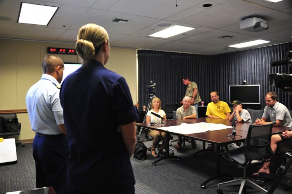 Lt. Max Seda and Petty Officer 1st Class Stacie Hudson, search and rescue coordinators in the Joint Rescue Coordination Center Honolulu, provide an overview of the James' family rescue coordinated by the Coast Guard Feb. 15, 2012 at the Prince Kuhio Jonah Kalanioniolai Federal Building. The James family recounted their experience during the rescue and provided feedback on the Coast Guard response in an effort to improve the search and rescue process. U.S. Coast Guard photo by Petty Officer 3rd Class Angela Henderson.