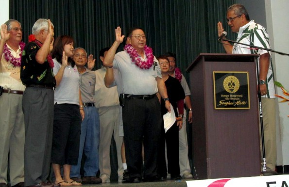 Hawaii County Mayor Billy Kenoi presents the oath of office to the new officers and directors of the East Hawaii Hiroshima Kenjin Kai.