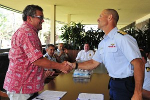 Hawaii County Mayor Billy Kenoi, left, shakes hands with Rear Adm. Charles W. Ray, commander of the 14th Coast Guard district after signing a memorandum of agreement Thursday (Feb 2). The memorandum coordinates local and federal responders together while conducting search and rescue missions. U.S. Coast Guard photo by Petty Officer 3rd Class Anthony L. Soto