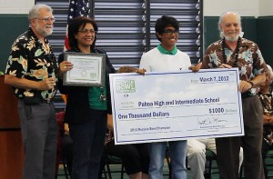 """Recycle Hawaii Executive Director Paul Buklarewicz and Education Director Howard Shapiro present the Keep America Beautiful """"Recycle-Bowl"""" national recognition award (www.Recycle-Bowl.org) and a check for $1,000 to Pahoa High and Intermediate School's Green Club."""