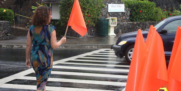 Pedestrians are encouraged to take a PedFlag, cross the street, and replace the flag in the holder on the opposite side for the next pedestrian's use