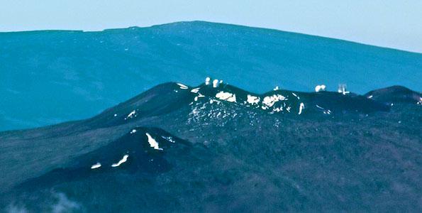 The summits of Mauna Kea (foreground) and Mauna Loa. Photo by Baron Sekiya | Hawaii 24/7