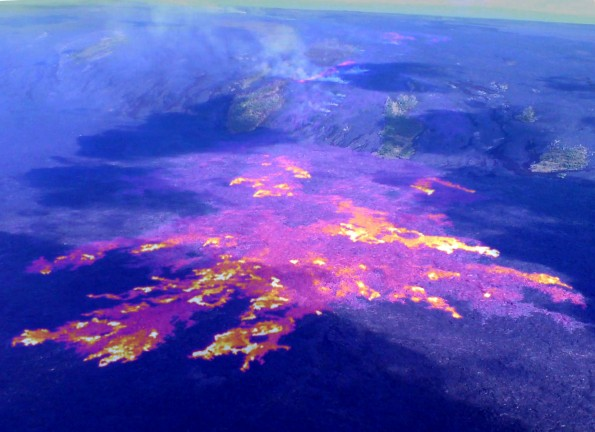 Active flows are still spread out across a broad area on the coastal plain, and advancement towards the ocean remains relatively slow. This image is a composite of a thermal image and normal photograph, with white and yellow areas showing active pahoehoe breakouts, and red areas showing inactive, but still warm, portions of the flow surface. On Thursday (April 26), the flow front (lower left corner of image) was about 900 meters (0.6 miles) from the ocean. The field of breakouts shown here is about 1.4 km (0.9 miles) wide. On the pali, a line of fuming areas marks the path of the lava tube through Royal Gardens subdivision. The fume from these sources partly obscures another narrow breakout on the pali. Photo courtesy of USGS/HVO