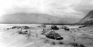 Katmai National Park and Preserve, Alaska. Ash drifts around houses at Katmai after the June 1912 eruption of Novarupta Volcano. August 13, 1912. Photo courtesy of USGS.