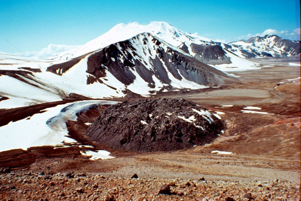 Katmai National Park and Preserve, Alaska. 80-meter (260-foot)high Novarupta, a blocky rhyolite lava dome that marks the vent for the June 1912 eruption that created the Valley of Ten Thousand Smokes. This eruption was the most voluminous on earth in the 20th century, ejecting nearly 30 cubic kilometers (7 cubic miles) of material in 60 hours. Falling Mountain, a lava dome truncated by the 1912 eruption, is visible behind the Novarupta dome. Snow-capped Mount Mageik volcano can be seen at the top. Photo courtesy of USGS by T. Miller, June 1979.