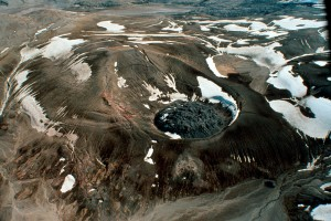Katmai National Park and Preserve, Alaska. 80-meter (260-foot)high Novarupta, a blocky rhyolite lava dome that marks the vent for the June 1912 eruption that created the Valley of Ten Thousand Smokes. This eruption was the most voluminous on earth in the 20th century, ejecting nearly 30 cubic kilometers (7 cubic miles) of material in 60 hours. Surrounding the dome is an oval-shaped ring of coarse tephra that accumulated during the waning explosive phases of the eruption. Photo courtesy of C. Nye, Alaska Division of Geological and Geophysical Surveys, August 1991.