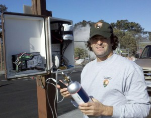 Hawai'i Volcanoes National Park Ecologist David Benitez checking the SO2 monitor at Steam Vents. Photo courtesy of HVNP