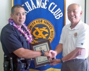 "Hilo Exchange Club member Joey Estrella congratulates April ""Officer of the Month"" Shea Nactor."