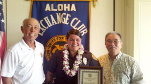 """Hilo Exchange Club member Joey Estrella and club president Jay Kimura present an 'Officer of the Month"""" plaque to Chere Lyons."""