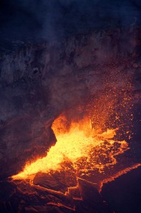 Vigorous spattering was present this evening along the western margin of the summit lava lake. Occasional bursts, like the one shown here, appeared to send tiny bits of spatter up to the level of the floor of Halemaumau crater. Photo courtesy of USGS/HVO