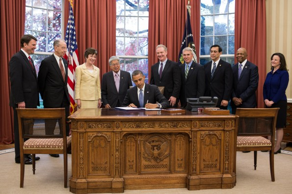 President Barack Obama signs S. 743, the Whistleblower Protection and Enhancement Act (WPEA), in the Oval Office, Nov. 27, 2012. Standing behind the President, from left, are: John Berry, Director of the Office of Personnel Management; Sen. Chuck Grassley, R-Iowa; Sen. Susan Collins, R-Maine; Sen. Daniel Akaka, D-Hawaii; Rep. Chris Van Hollen, D-Md.; Rep. Todd Platts, R-Pa.; Rep. Darrell Issa, R-Calif.; Rep. Elijah Cummings, D-Md.; and Special Counsel Carolyn Lerner. (Official White House Photo by Pete Souza)