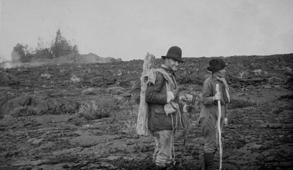 Thomas Jaggar and his wife, Isabel, hiking on Mauna Loa during the September 1919 Southwest Rift Zone eruption.  USGS archive photo.