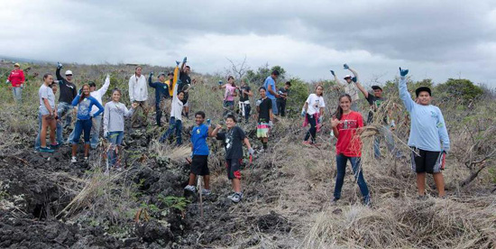 Kealakehe Intermediate Na Kahumoku students after pulling fountain grass at Lai Opua Preserve. This activity was followed up with an hour of reinforcing e-curriculum at the Lai Opua 2020 Mālie Tech Center. (Photo courtesy of Yvonne Yarber Carter)