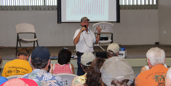 Tommy Greenwell speaks to farmers at Kona Coffee Farmers Association's annual expo at Old Kona Airport. (Hawaii 24/7 photo by Karin Stanton)