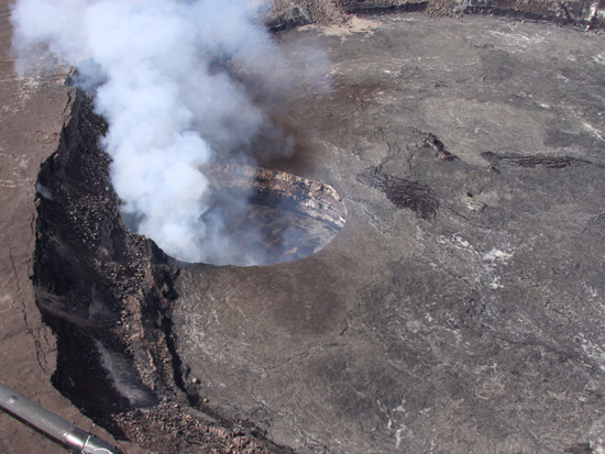 """Halemaumau Crater - March 2013. Kilauea Volcano's summit vent """"then and now."""" In April 2008, a month after it opened, the vent within Halemaumau Crater was about 115 feet in diameter. As of March 2013, it is more than 500 feet across. (Photos courtesy of USGS)"""