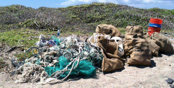 "The 209.6 lbs of ""marine debris"" loot (e.g., fishing nets, miscellaneous plastic debris and a bucketful of microplastics) during less than an hour of scouring by HWF and volunteers at Kamilo. (Photo courtesy of Harold Leatherman 