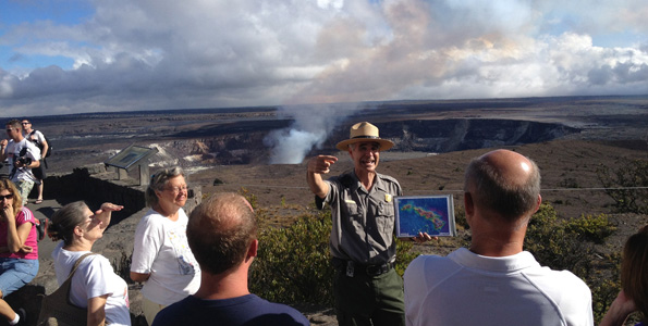 """Park Ranger Dean Gallagher engages visitors with a """"Life on the Edge"""" talk, held daily at the Jaggar Museum Overlook in Hawaii Volcanoes National Park. (Photo courtesy of NPS)"""