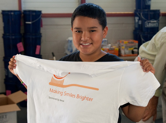 A brighter smile and a new T-shirt. (Photo courtesy of Xerox Hawaii)