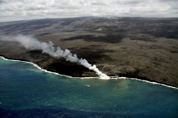 Two ocean entry points remain active near Kupapaʻu Point, near the boundary of Hawaiʻi Volcanoes National Park. The eastern entry has produced a larger plume than that at the western entry, which tends to be weak and wispy. On Tuesday (June 11) several small breakouts were active just inland of the eastern entry point, creating a narrow cascade of lava pouring down the sea cliff. Photo courtesy of USGS/HVO