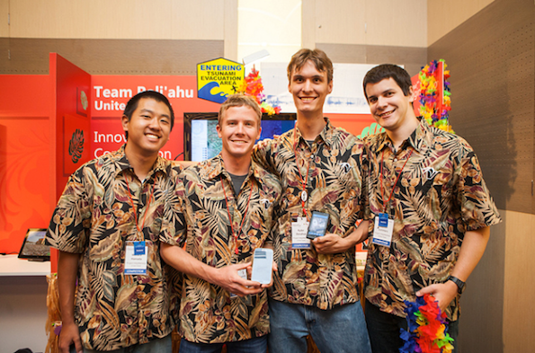 UH Hilo Team Poli`ahu (L-R): Wallace Hamada, Mike Purvis, Ryder Donahue, and Kayton Summers pose in front of their booth at the 11th worldwide Imagine Cup in St. Petersburg, Russia. (Photo courtesy of UH Hilo)