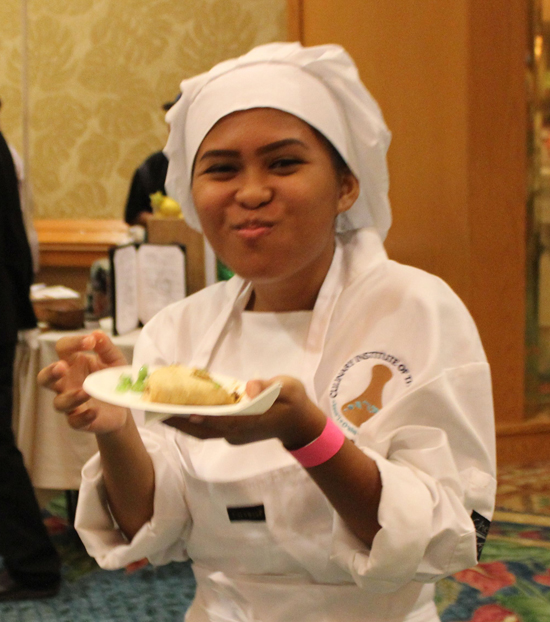 A culinary student samples a dish. (Hawaii 24/7 photo by Karin Stanton)