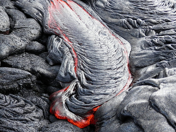 Active pāhoehoe breakouts are scattered across portions of the Kahaualeʻa 2 flow. This photo shows a nice example of ropy pāhoehoe active near the flow margin. Photo courtesy of USGS/HVO