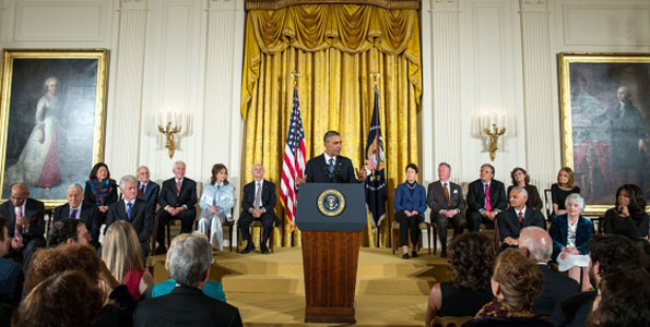 """President Barack Obama delivers remarks and awards the 2013 Presidential Medal of Freedom to honorees during a ceremony in the East Room of the White House, Nov. 20, 2013. Honorees are: Ernie Banks, Ben Bradlee, former President Bill Clinton, Daniel Inouye (posthumous), Daniel Kahneman, Richard Lugar, Loretta Lynn, Mario Molina, Sally Ride (posthumous), Bayard Rustin (posthumous), Arturo Sandoval, Dean Smith, Gloria Steinem, Cordy Tindell """"C.T."""" Vivian, Patricia Wald, and Oprah Winfrey. (Photo courtesy of Pete Souza   White House)"""