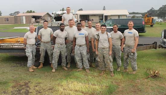 Wolfhounds and Cobras join to take a picture before saying goodbye to the Waimea community. Soldiers learned a new way to serve by volunteering along side of Habitat for Humanity West Hawaii during a home restoration project.  (Photo courtesy of 2nd Lt. Sheme Hicks   U.S. Army)