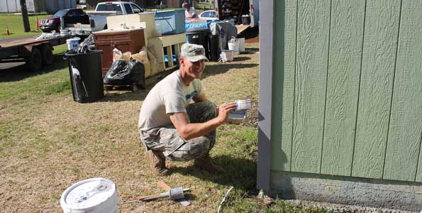 Sgt. Dallas Keck, Section Chief from 2nd Battalion, 11th Field Artillery Regiment, 2nd Stryker Brigade Combat Team, 25th Infantry Division touches up garage trim paint. (Photo courtesy of 2nd Lt. Sheme Hicks   U.S. Army)