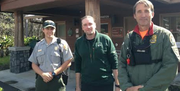 Rescued hiker Alex Sverdlov (middle) stands with his rescuers, park rangers John Broward (right) and Tyler Paul outside the park's Visitor Emergency Operations Center on Thursday. (Photo courtesy of J. Ferracane | NPS)