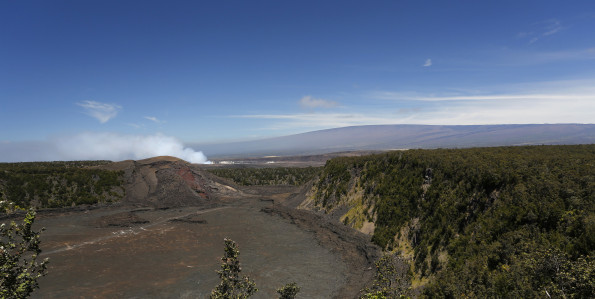 One of the most popular vantage points and hiking trails in Hawai'i Volcanoes National Park: Kīlauea Iki crater and trail, with Halema'uma'u plume,and Mauna Loa, both seen in the distance. NPS Photo/Michael Szoenyi