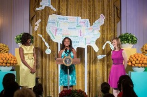 First Lady Michelle Obama and Epicurious Editor Tanya Steel listen as 12-year-old Haile Thomas, last year's recipe winner from Arizona, introduces Mrs. Obama during the Kids' State Dinner in the East Room of the White House, July 9, 2013. (Official White House Photo by Lawrence Jackson)