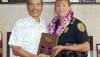 Police Chief Harry Kubojiri presents a plaque to Officer Denise Smith-Erickson, State of Hawaiʻi D.A.R.E. Officer of the Year.