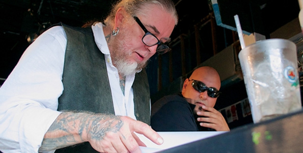 Richard Gonzalez, or Bullitt, looks on as Rockwood flips through a script. (Photo courtesy of GIFilms)