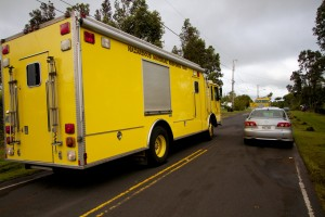 Traffic was diverted around the area of a structure fire in Kaumana as fire crews responded to the blaze. Photography by Baron Sekiya | Hawaii 24/7