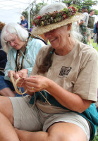 Visitors enjoy the ulana lauhala workshop. NPS Photo by Jay Robinson