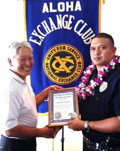 Hilo Exchange Club President Andy Iwashita presents an 'Officer of the Month' award to Officer Eddie Cardines Jr.