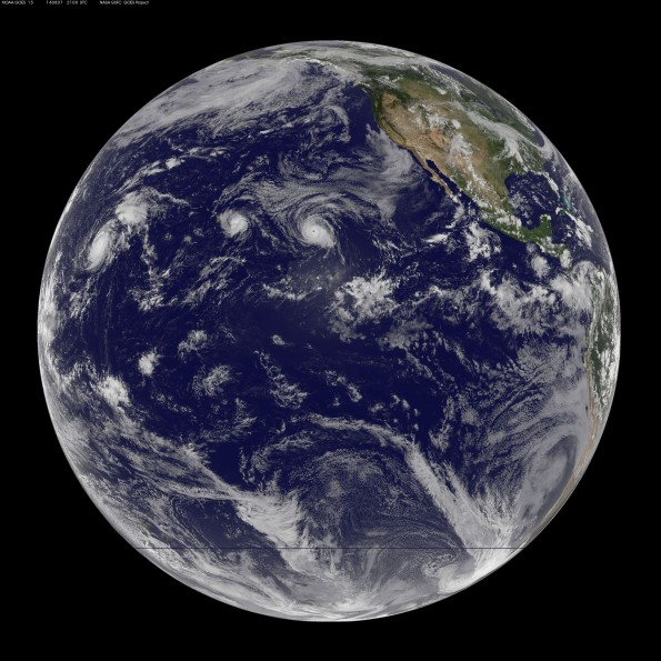Full disk Earth image captured at 11 a.m. HST Thursday, August 7, 2014. You can clearly see Hurricane Iselle close to the Big Island while Hurricane Julio is flowing Iselle's lead. Image courtesy of NOAA-NASA GOES Project