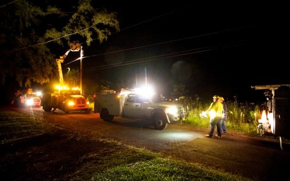 A Hawaiian Electric crew works late at night in Hawaiian Paradise Park restoring power to homes for residents. Photography by Baron Sekiya | Hawaii 24/7