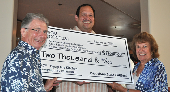 Kamehameha Schools Land Asset Manager Les Apoliona (center) presents a check for the Equip the Kitchens Campaign to James Lightner, Hospitality and Tourism Program coordinator of UH-Hawai'i Community College and Jean Hull, Equip the Kitchens campaign manager of ACF Kona Kohala Chefs. (Photo courtesy of Kamehameha Schools)