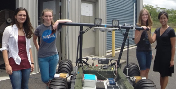 From left, Catherine Cauley, Sage Doreste, Emily Strawn, and Mari-Ela David Chock with the PISCES Rover during the STARS workshop. (Photo courtesy of PISCES)