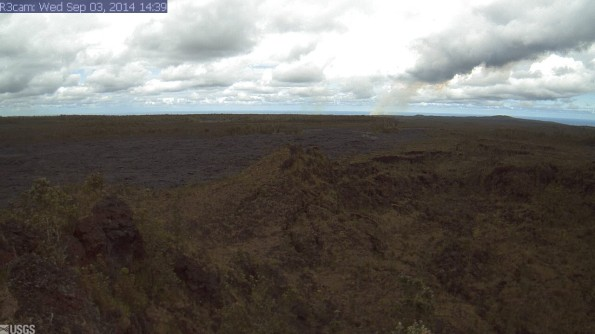 This image is from a research camera positioned northeast of Puʻu ʻŌʻō, near the east margin of the Puʻu ʻŌʻō lava flow field, monitoring the June 27th lava flow.  The camera looks northeast, down the East Rift Zone. The cone near the right side of the image is Heiheiahulu. Image taken at 2:39 p.m. September 3, 2014. Photo courtesy of USGS/HVO