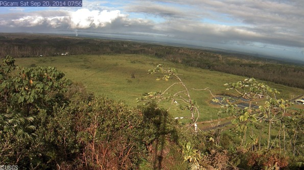 Webcam image taken at 7:56 a.m. Saturday (Sep 20) of Kilauea's June 27th Flow and the Lower East Rift Zone. The camera is positioned near Kapoho looking Northwest.  From left to right on the horizon, one can see Puʻu ʻŌʻō vent near the left edge of the image, the gas plume from Halemaʻumaʻu crater (when clear enough), with Mauna Loa and Mauna Kea farther to the right. The advancing front of the June 27th lava flow is burning vegetation and sending smoke aloft in the left center of the image.  Photo courtesy of USGS/HVO