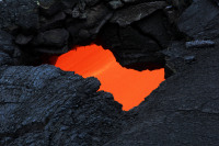 A skylight provided a view of the swiftly moving lava stream in the lava tube Wednesday, October 1, 2014. Photo courtesy of USGS/HVO