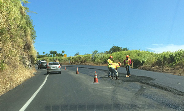 Crews working on Laupahoehoe Gulch roadway on October 7, 2014. Hawaii 24/7 File Photo