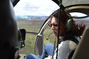 Rep. Tulsi Gabbard on a helicopter with Hawaii County officials to get a close look at the Kilauea June 27th Lava Flow, its path toward Pāhoa, access roads in and out of Puna, including the work on Chain of Craters Road. Photo courtesy Rep. Gabbard's office