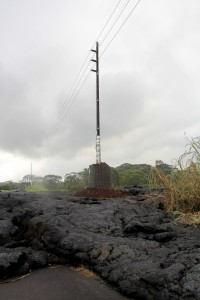 A HELCO utility pole which was hardened against the onslaught of the lava flow appears to be surviving in the lava flow Saturday (Oct 25). Photo courtesy of HELCO